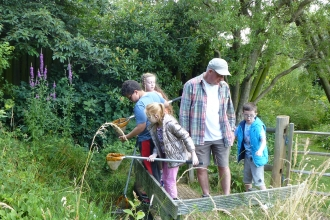 Children pond dipping at EcoPark