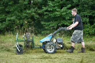 Senior Conservation Officer Tom making hay