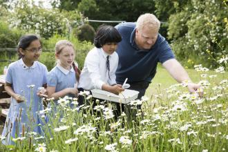 Children learning about wild flowers at EcoPark