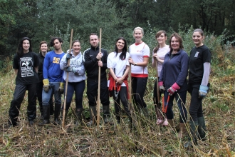 Knight Frank employees and Trust staff clearing the fen