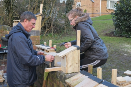 Friends of Hill Hook building bird boxes for the site